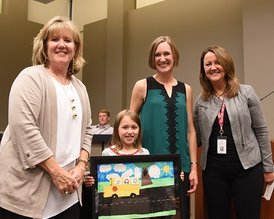 Cathy Olig receiving the Friend of Education award from the Menomonee Fallls School Board
